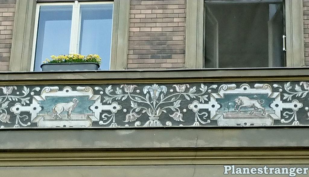 zodiac signs on buildings prague